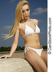 beautiful blonde woman in white bikini