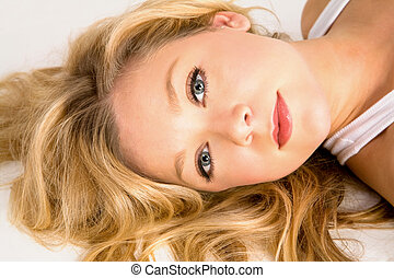 Beautiful Blonde Woman Laying Down