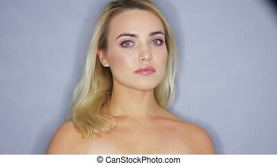 Beautiful blonde woman looking at camera - Headshot of young...