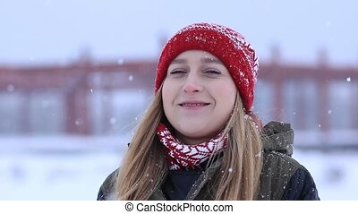 Beautiful blonde woman on a snowy winter day