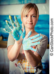 beautiful blonde woman painter