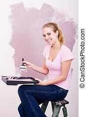 beautiful blonde woman painting home