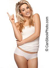 Beautiful blonde woman pointing upwards - Beautiful blonde...