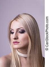 Beautiful blonde woman posing at studio