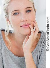 Beautiful blonde woman smiling at the camera