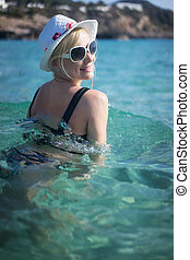 beautiful blonde woman swimming in the sea