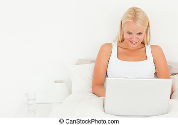 Beautiful blonde woman using a laptop