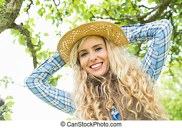 Beautiful blonde woman wearing a straw hat