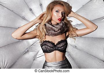 Beautiful blonde woman wearing lingerie