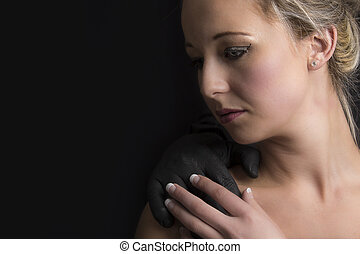 Beautiful blonde woman with a black hand of man on her shoulder