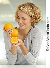 beautiful blonde woman with an orange smiling