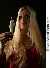 Beautiful blonde woman with candle in hand