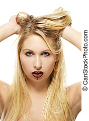 beautiful blonde woman with chocolate covered lips on white background
