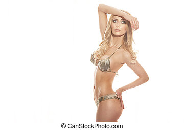 Beautiful blonde woman with fitness shape and healthy long hair posing isolated on white background.