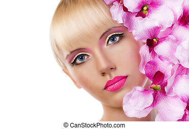 Beautiful blonde woman with flowers and pink makeup