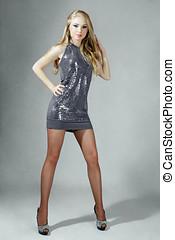Beautiful blonde woman with long hair studio shot