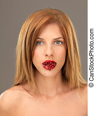 beautiful blonde woman with mouthfull of berries