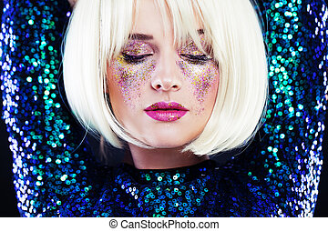 Beautiful Blonde Woman with Party Glitters Makeup