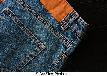 Beautiful blue and black jeans close up
