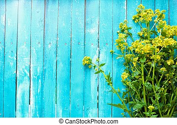 Beautiful blue background with yellow wildflowers