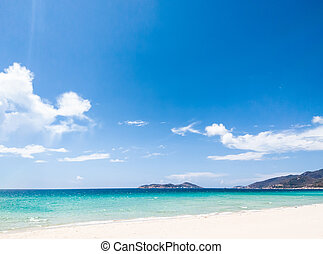 Beautiful blue beach panoramic sea view, with clean Azure water, blue sky, white clouds. Idyllic cloudscape