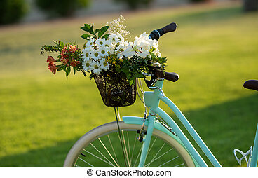 Beautiful blue bicycle with a basket of flowers