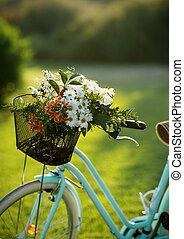 Beautiful blue bike with a basket of flowers
