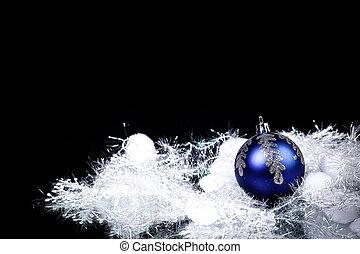 beautiful blue Christmas ball on a black background
