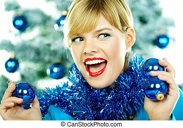 Beautiful Blue Christmas - Beautiful young woman next to ...