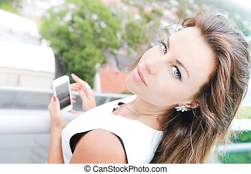 Beautiful blue-eyed woman looking up