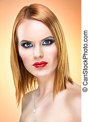 Beautiful blue-eyed woman with extreme makeup