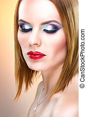 Beautiful blue-eyed woman with luxury make-up