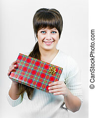 beautiful blue eyed young happy smiling girl with a gift box