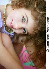 Beautiful blue eyes little girl smiling