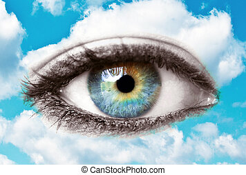 Beautiful blue human eye with bright sky - Spiritual concept...