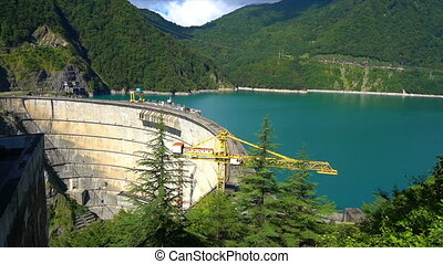beautiful blue lake on a dam, a hydroelectric power station.