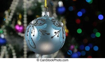 Beautiful blue New Year and Christmas decoration ball swinging on rope