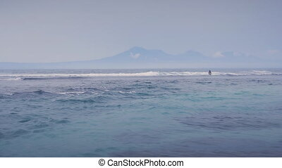 Beautiful Blue Ocean Waves and a mountain at background in...