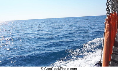 Beautiful blue Pacific Ocean ship bow wave wake. Slow...