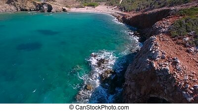 Blue sea, waves breaking in cliffs at shore - Beautiful Blue...
