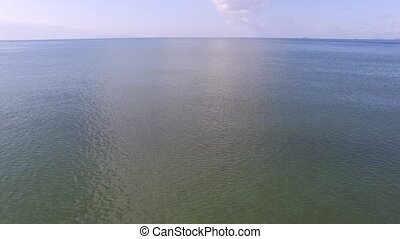 beautiful blue seaside - aerial drone flying over beautiful...