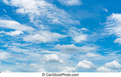 Beautiful blue sky and white cumulus clouds abstract background. Cloudscape background. Blue sky and fluffy white clouds on sunny day. Nature weather. Cotton feel texture. White soft clouds background