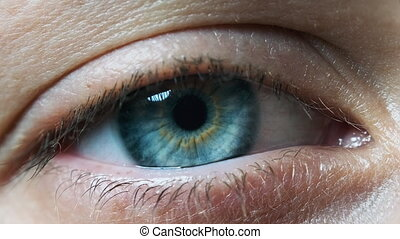 Blue Woman Eye, Extreme Close-up. Beautiful blinking young female with blue with brown color of the eye. Amazing Sight. Slow motion. Eyeball with retina, blood vessels. Macro. Film look 4K, 4.2.2