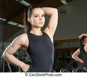 Beautiful body builder posing