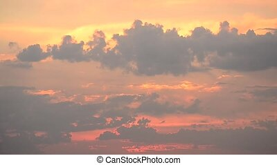 Beautiful boiling colorful cumulus clouds moving at sunset