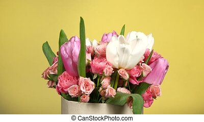 Beautiful bouquet flower with roses and tulips, on yellow,...