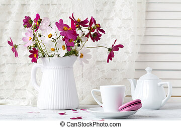 Beautiful bouquet flowers in vase on table