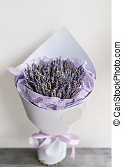beautiful bouquet lavender on table . dried flowers lilac color. placed in a paper bag