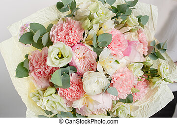 beautiful bouquet made of different flowers with in woman hand . colorful color mix flower