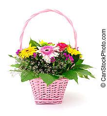 Beautiful bouquet of bright flowers in basket.